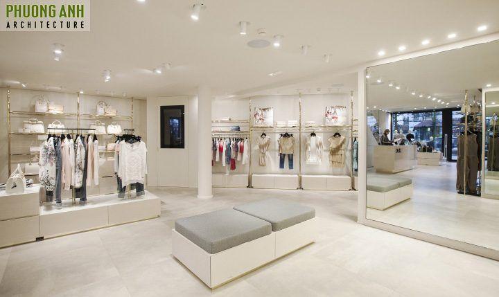 Trang trí nội thất shop quần áo với tấm gương lớn giữa phòng