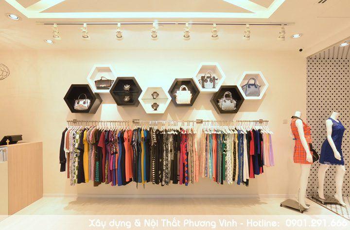 Mẹo trang trí nội thất shop quần áo nổi bật với các khối lục giác. trang-tri-noi-that-shop-quan-ao-don-gian-voi-khoi-luc-giac-gan-tuong